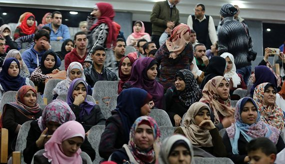 "People gather to watch the film ""Oversized Coat"" in the Gaza Strip, Jan. 16, 2016. (photo by FACEBOOK/Gaza Cinema) Read more: http://www.al-monitor.com/pulse/originals/2016/01/palestinian-film-industry-gaza-cinema.html#ixzz3zHIkTvDW"