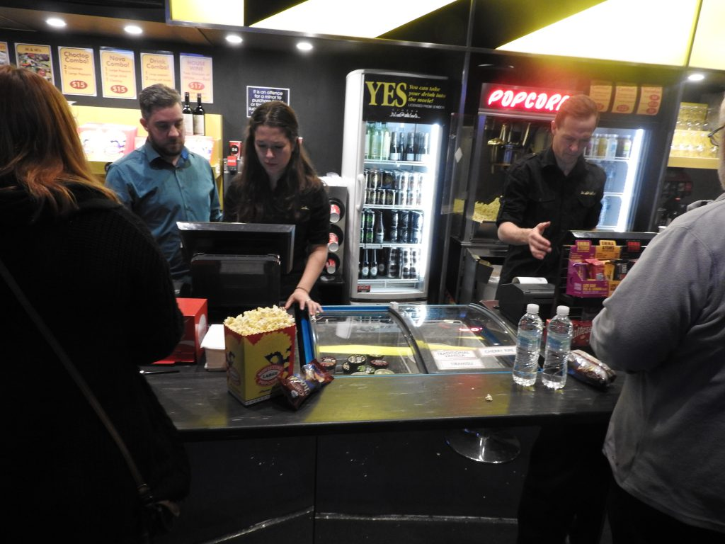 Serving popcorn and wine at Cinema Nove, Melbourne.