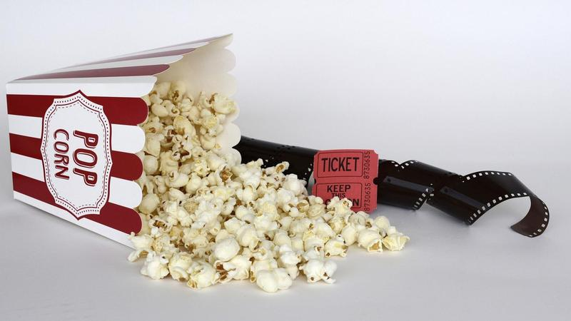 Cinema popcorn, ticket and reel