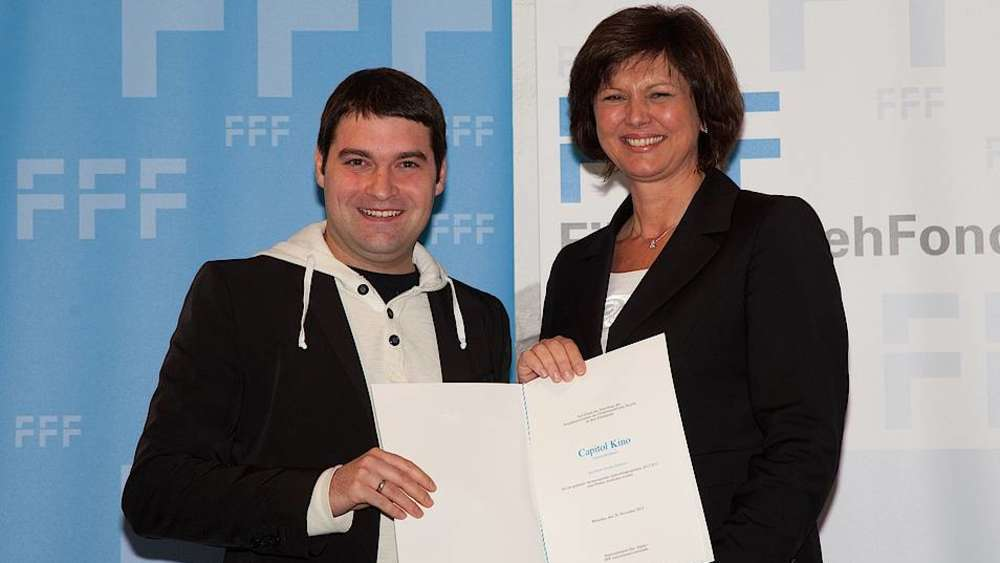 Capitol's Stefan Stefanov receiving an award from Bavaria's Deputy-MinisterPresident  Ilse Agner. (photo: FKN)