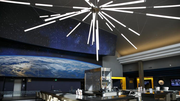 The Space Age bar and a lounging area from a new multimillion-dollar renovation of the Universal CityWalk AMC theater. (photo: Marcus Yam / Los Angeles Times)