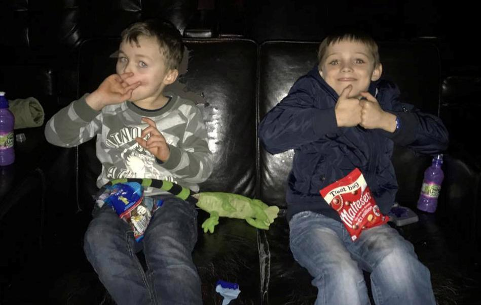 Alfonso and his brother Harry in the cinema. (photo: The Sun)