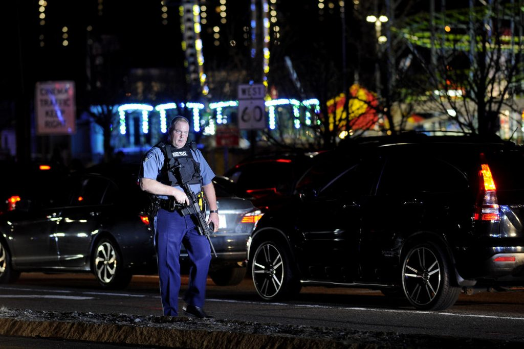 State trooper walks along Squire Road in Revere. (phoot: Boston Herald / Joseph Prezioso)