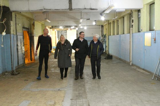 The Montrose Playhouse team admire the work. (photo: The Courier)