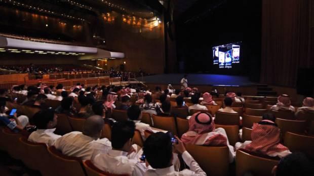 Saudi men watching a short film competition in Riyadh. (image: AFP)