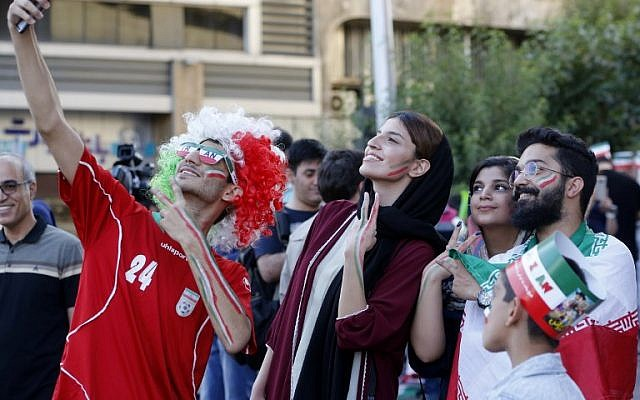 Iranians pose for a selfie before watching the World Cup Morocco-Iran match at Azadi cinema in Tehran. (photo: AFP/Atta Kenare)